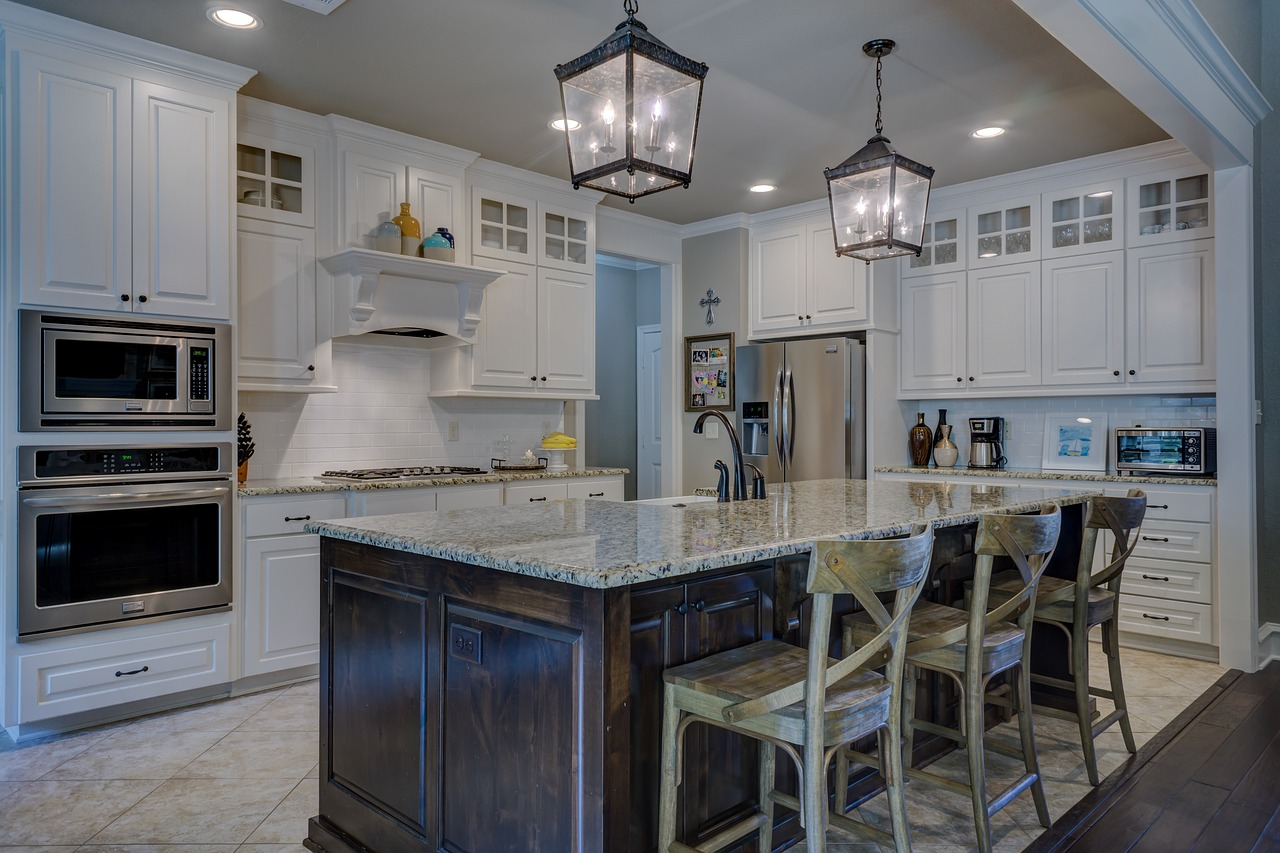 Luxurious kitchen with white granite countertops.